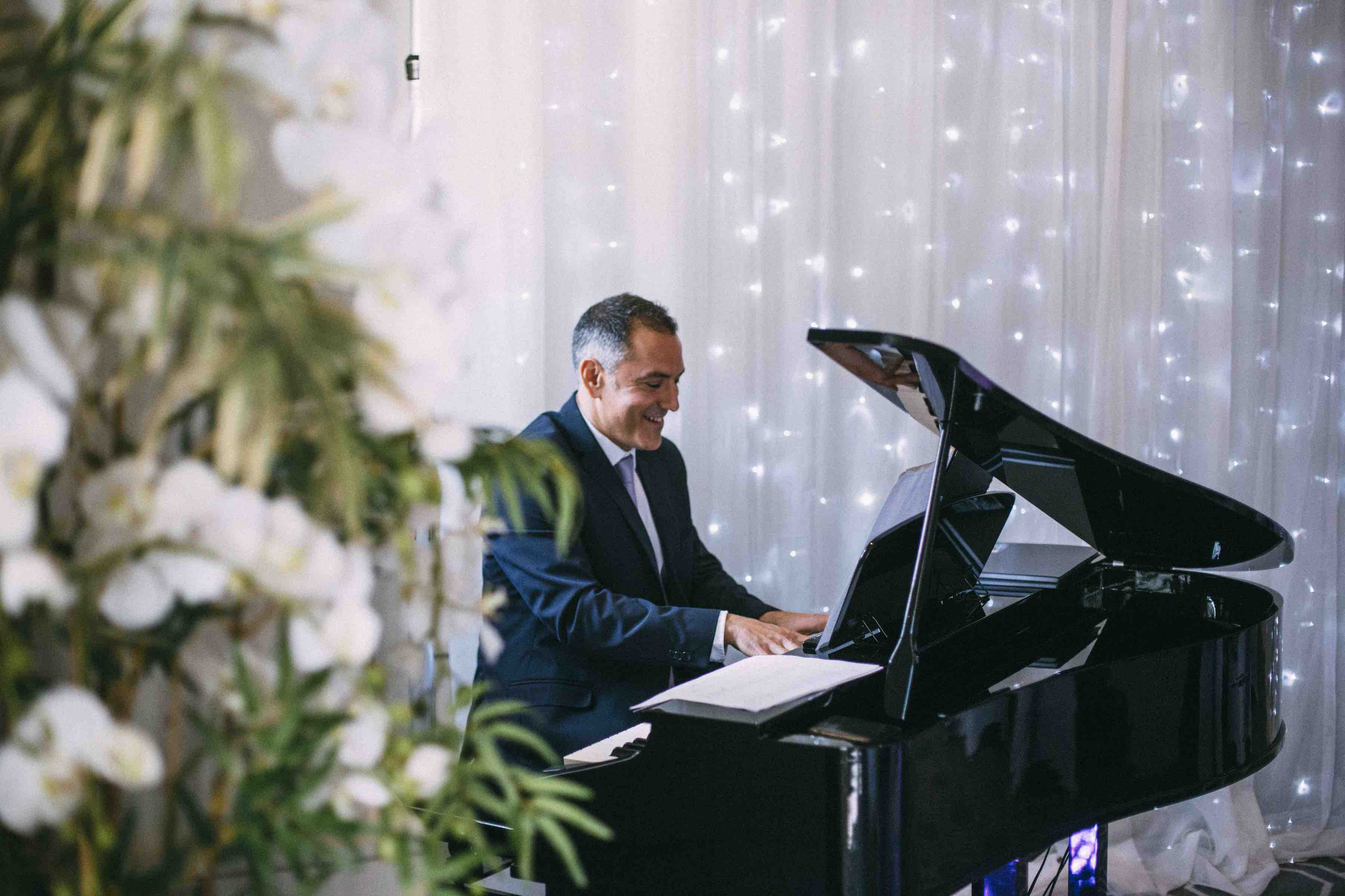 Playing-digital-baby-grand-Dale-Abs-wedding