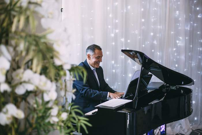 playing-a-black-digital-baby-grand-during-dinner