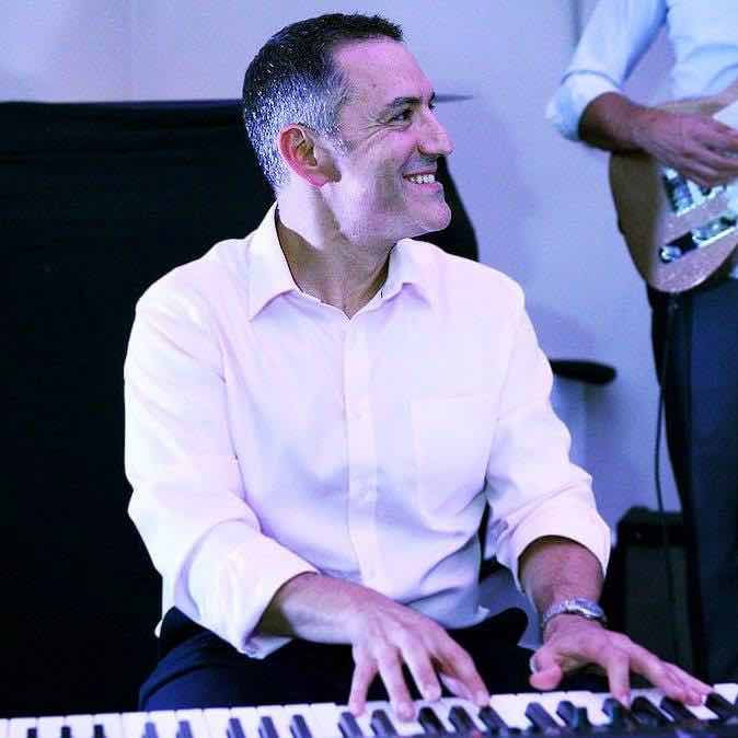 playing-the-keyboard-and-joined-by-other-musicians-at-a-big-party