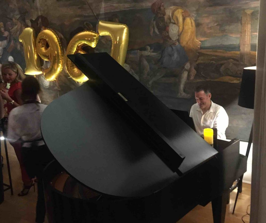 playing-the-grand-piano-for-a-50th-birthday-party-in-a-period-home