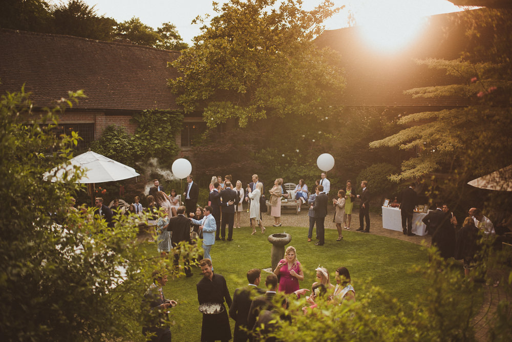 Bryan-Edery-Pianist-to-play-at-Outdoor-Wedding-Drinks-Reception-Ramster-Hall-Courtyard-Chiddingfold-May-2018