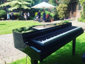 portable-baby-grand-piano-outdoor-drinks-reception-ramster-hall.jpg